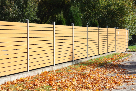 Wooden fence in the coutryside in autumn
